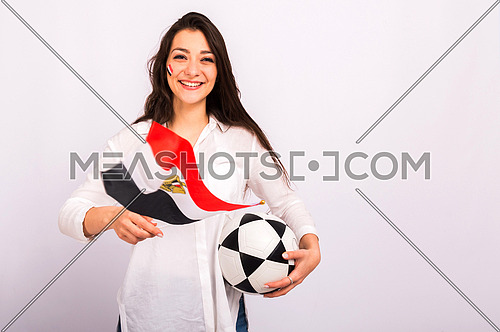 A beautiful young woman encourages the Egyptian football team, holding the flag of Egypt