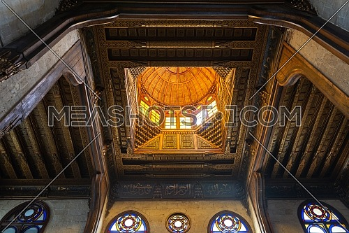 Wooden decorated dome mediating ornate wooden ceiling with floral pattern decorations at Sultan al Ghuri Mausoleum, Cairo, Egypt