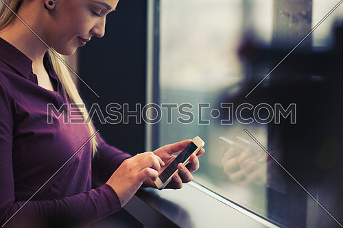 business woman at office using smart phone to check internet and type messages