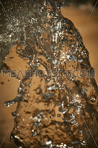 Close Up shot for Water Pouring in sand sat day