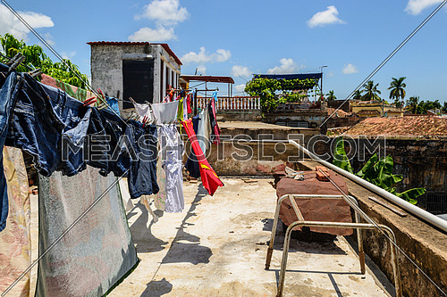 In the picture of the clothes hanging with rope on the terrace in Cuba.