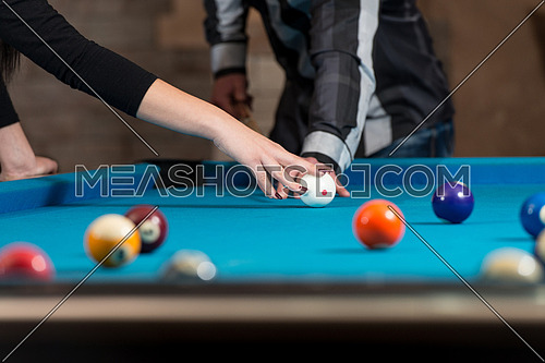 Close Up Of A  Man Receiving Advice On Shooting Pool Ball While Playing Billiards