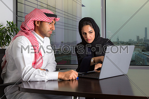 Female employee discussing her part in the meeting