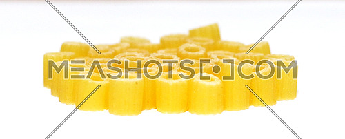 macaroni beads stands vertically on a white background