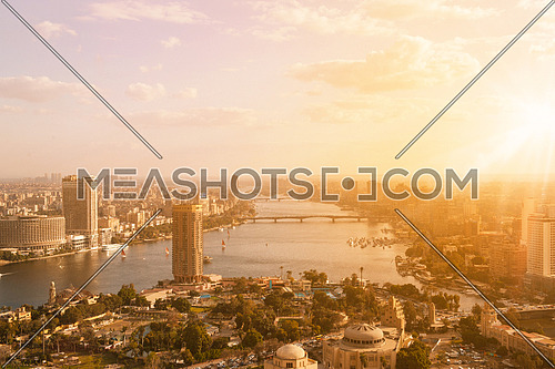 aerial view of modern Cairo city downtown with Nile and pyramids in the distance at beautiful sunny day with blue sky and clouds capital of Egypt