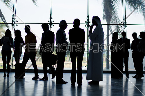 two guys crossing in a business meeting that includes a khaliji man with CEO of the company