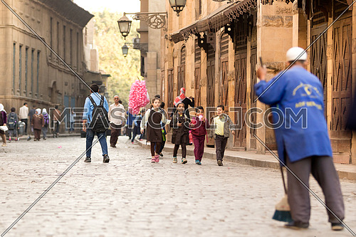 Young Girls walking to school early morning in El-Moez Street