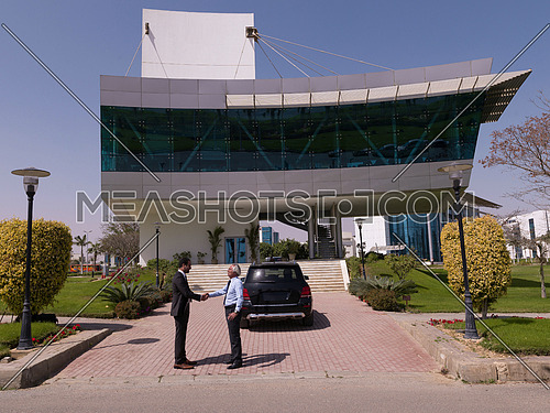 business people handshake and make deal  in front of modern corporate  building