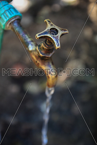 Brass rusty Water tap in an rural village
