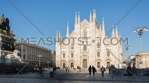 Milan, Italy - May 03, 2021: Crowd of tourists in the square in front of the Duomo of Milan,sunny day time lapse,Italy.