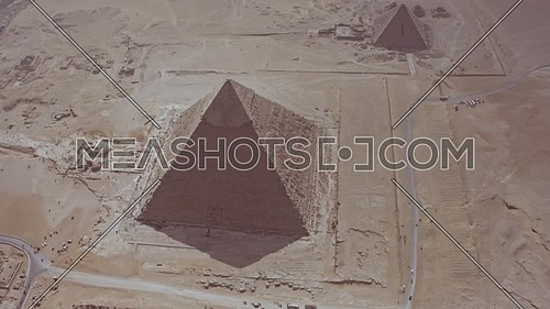 Fly over Shot Drone for The Great Pyramids of Giza from The Pyramid of Khafre in giza at day