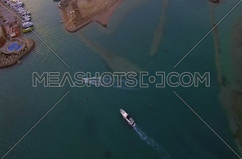 Drone shot flying above A yacht going to AL Gouna Marina at Day