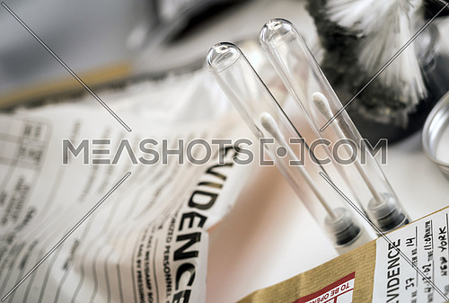 Detail of DNA sampling tubes in Laboratorio forensic equipment, conceptual image