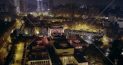 Drone shot fly over Cairo Opera house in Cairo at night