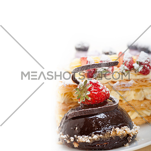 selection of fresh cream napoleon and chocolate mousse cake dessert plate