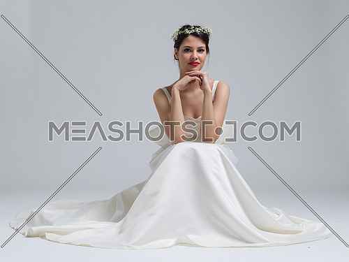 Photo For Beautiful Young Bride Sitting In A Wedding Dress Isolated On White Background Meashots