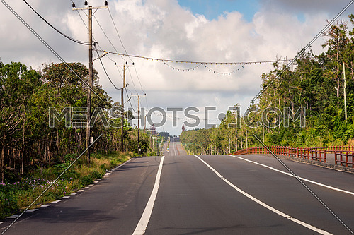 A big road to Grand Bassin lake at mauritius,background two huge staue of hindu religion.