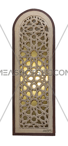 Perforated arched stucco window decorated with stain glass with geometrical patterns, one of the traditions of the Mamluk era, isolated on white