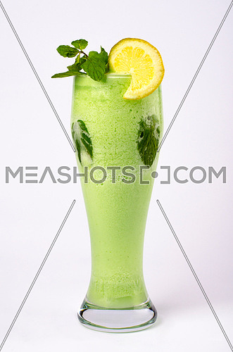 lemon with peppermint in a tall glass isolated on white