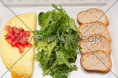 home made omelette with cheese tomato and rucola rocket salad arugola