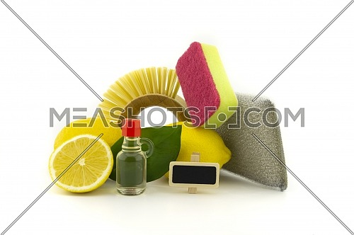 Home cleaning means, such as brush, cloth, foam sponge, acid and lemons for stain removal and freshness. Studio shot isolated on white background
