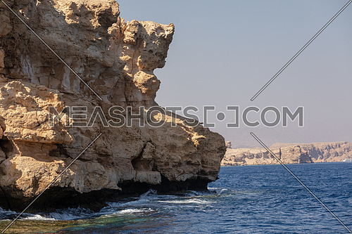Close up shot from Red Sea showing Ras Muhammed Island by day