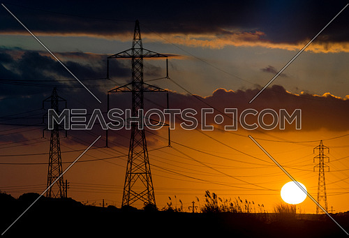Sunset with Electric power towers and cables at north-coast of Egypt