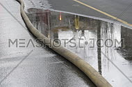 fire hose in a street during fire fighting
