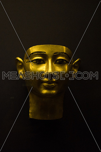 Copper Mask on black background  in the Egyptian Museum