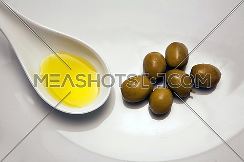 Green olives in a white bucket, a typical product of Andalusia, Spain