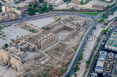 Birds eye top shot for Luxor Temple photo at sunrise , flying over with hot balloons, from the west side of luxor ,