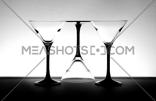 three drinking glasses placed in an abstract style