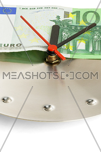 euro bill on a metal wall clock on white background