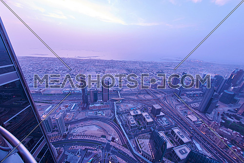 Dubai night skyline. Dubai streets by night. Al Yaqoub tower Dubai. Dubai Millennium Plaza. Dubai Sheikh Zayed Road by night. Dubai night view. Dubai cityscape by night. Dubai metro station view.