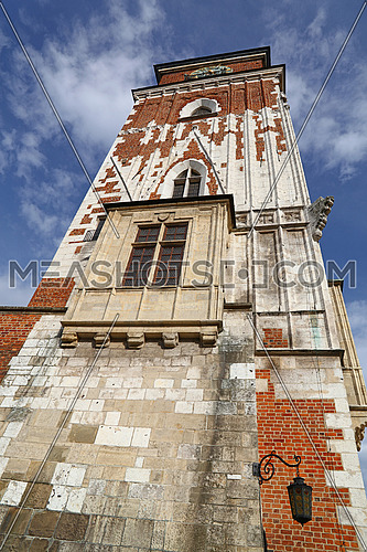 Low angle view of Town Hall tower at Main Market Square of Krakow, Poland