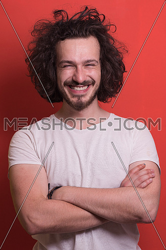 Portrait of a beautiful  young man with funny hair over color background with copyspace expressing different emotions