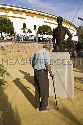 "LINARES, SPAIN - August 29: Man looking monument to the spanish bullfighter ""Manolete"" in Linares, Jaen province, Spain"