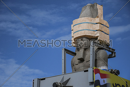 mid shot for The Statue of King Ramses II on the transferring machine showing sky and clouds while transferring process to the Grand Egyptian Museum in Cairo on 25 January 2018