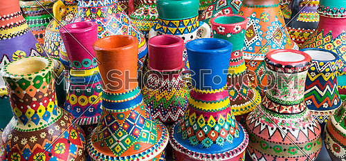 Angled view showing a composition of artistic painted handcrafted pottery vases