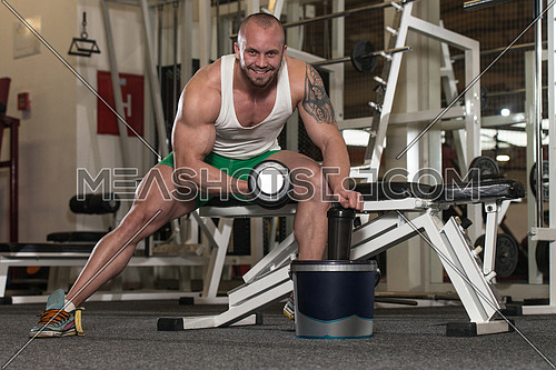 Young Man Working Out Biceps - With Pills And Dope For Copy Space