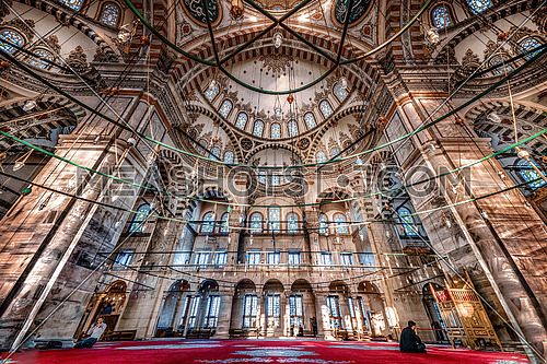 wide angle shot inside Sultan Ahmed's Mosque in Istanbul.