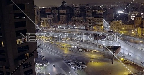Drone shot for 6 of October Bridge over Abd Elmonan Reyad Bus Station At Tahrir Area in cairo at night