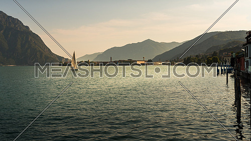 In the picture a view of Lake Iseo from the city of Lovere, on the side left of a sailboat.