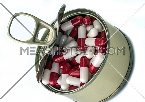 Can full of white and red capsules, conceptual image