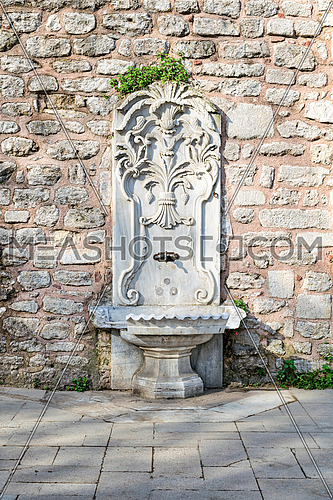 Marble sculpted drinking fountain at Gulhane Park, Sultan Ahmet district, Istanbul, Turkey