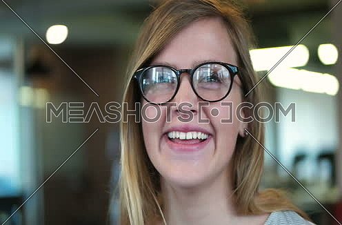 tracking shot of  Young Woman In A Startup Office