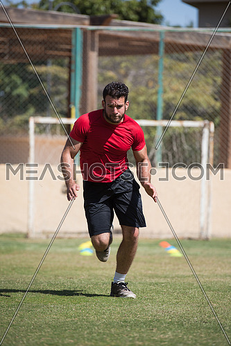 young middle eastern man athlete training running on the pitch on a sunny day