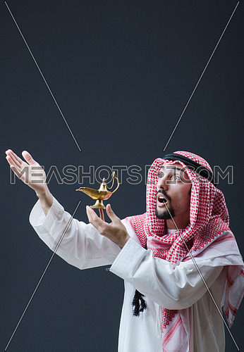 Portrait of young arab with lamp