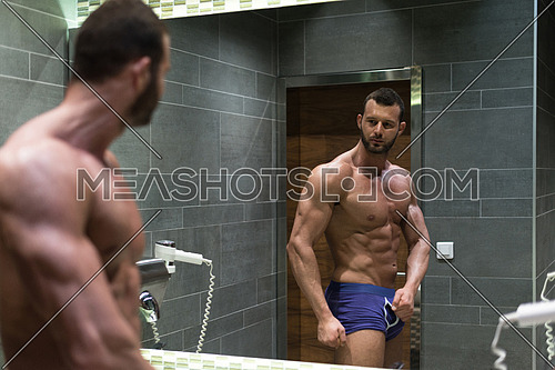 Portrait Of A Physically Fit Man Posing In A Bathroom