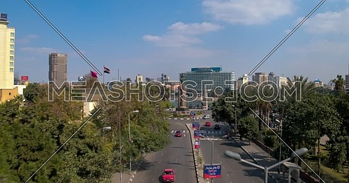 Drone Shot flying beside Cairo Opera House Backwards from Saad Zaghloul Statue showing Qasr Al Nile Bridge and Nile Ritz Carlton Hotel in background at day time